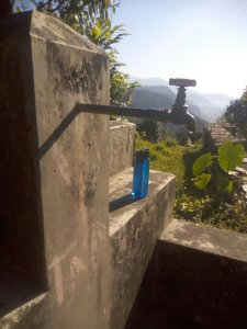 lifestraw beside a contaminated water tap