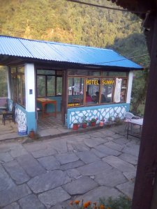 a picture of the restaurant at out guesthouse with a beautiful view behind.
