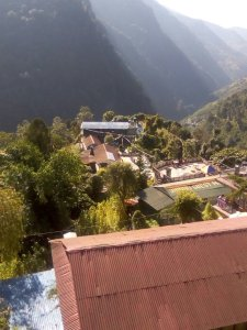 a birds eye view of our guesthouse with the mountains in the background